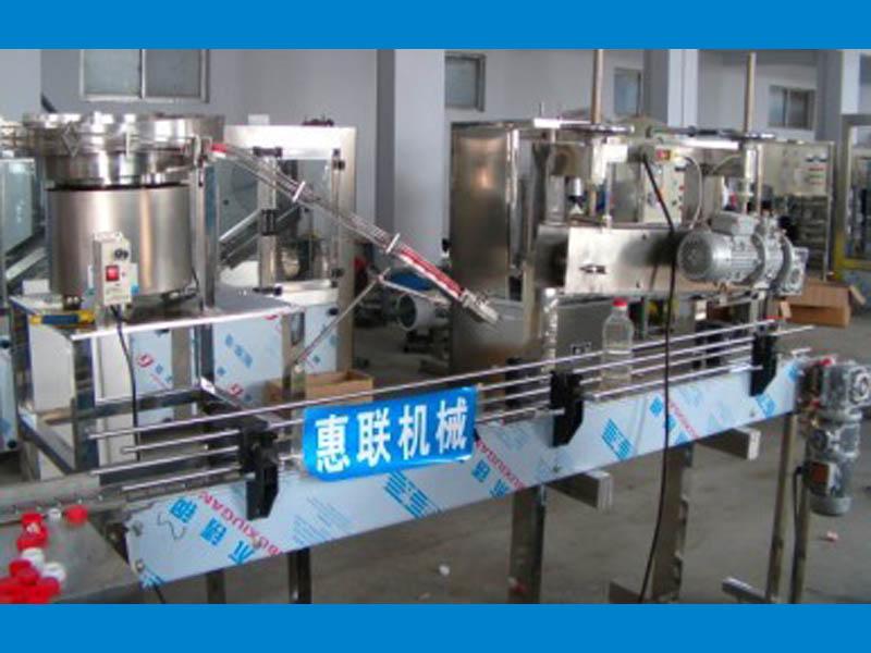 灌装生产线配套自动理盖压盖机